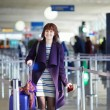 Young female passenger at the airport — Stock Photo #66703807