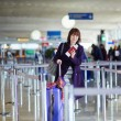 Young female passenger at the airport — Stock Photo #66703921