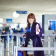 Young female passenger at the airport — Stock Photo #66704019