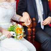 Bride and groom holding hands during the ceremony — Stock Photo
