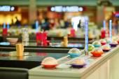 Sushi plates on rails in restaurant — Stock Photo