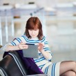 Young passenger at the airport, using her tablet — Stock Photo #70102375