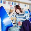 Passenger at the airport, doing self check-in — Stock Photo #70102577