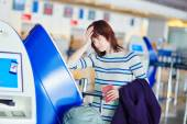 Passenger at the airport, doing self check-in — Stock Photo