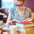 Beautiful young student with lots of books — Stock Photo #70154951