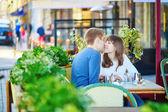 Romantic couple in a Parisian street cafe — Стоковое фото