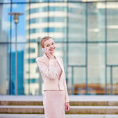 Young confident business woman using phone — Stock Photo