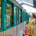 Young beautiful Parisian woman in subway — Stock Photo #72463441
