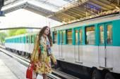 Young beautiful Parisian woman in subway — Stock Photo
