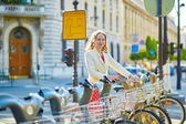 Beautiful young woman with a bicycle — Stock Photo