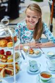 Beautiful young woman enjoying afternoon tea — Stock Photo