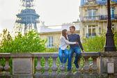 Romantic loving couple near the Eiffel tower — Stock Photo