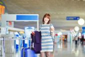 Beautiful young female passenger at the airport — Stock Photo