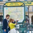 Family in Paris, looking at subway map — Stock Photo #76569329