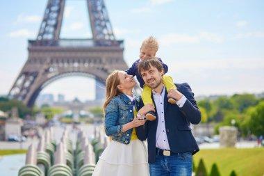 Happy family of three in Paris