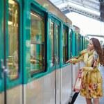 Beautiful young woman running to catch a train — Stock Photo #79053402
