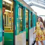 Beautiful young woman running to catch a train — Stock Photo #79053836