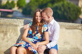 Young romantic couple having on the Seine embankment — Stock Photo