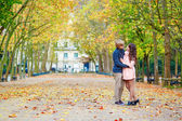 Young dating couple in Paris on a fall day — Stock Photo
