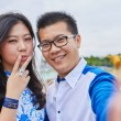 Beautiful Asian couple taking selfie in Paris — Stock Photo #80814930