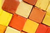 Creative art background - closeup of bright pastel crayons with yellow,orange,red and ochre colours — Stock Photo