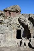 Cross-stones and entrance to monastic cells of Geghard rock monastery,Armenia, Caucasus, unesco world heritage site — Stock Photo