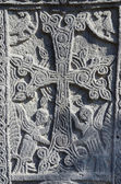 Stone carving - christian cross with mythical creatures in Ejmiadzin ancient monastery ,Armenia,Caucasus, unesco heritage site — Stock Photo