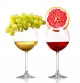 Glass of red and white wine, grape and grapefruit on a white bac — Stock Photo
