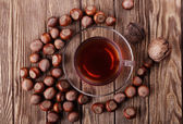 Autumn harvest. nuts on a dark recycled wood background, with copy space .. Top view of tea, nuts — Stock Photo