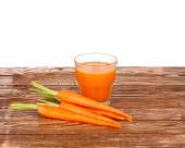 Healthy food - carrots and carrots juice — Stock Photo