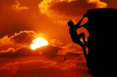 Teamwork couple hiking help each other trust assistance silhouette in mountains, sunset. Teamwork of man and woman hiker helping each other on top of mountain climbing team — Stock Photo