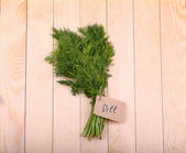 Fresh green dill on old wooden background — Stock Photo