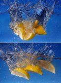 Collage  Whole lemon dropped in water against gradient blue background — Stock Photo