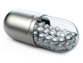 Metellic capsule with vitamins and minerals. — Stock Photo