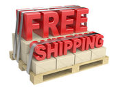 3D free shipping text and cardboard boxes on pallet — Stock Photo