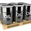 Black oil barrels on wooden pallet  — Stock Photo #68476859