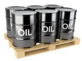 Black oil barrels on wooden pallet — Stock Photo