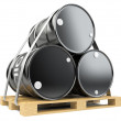 Black oil barrels on wooden pallet  — Stock Photo #68838855
