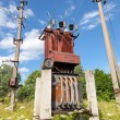 Power transformer against the blue sky background — Stock Photo #53321251