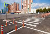 White traffic markings with a pedestrian crossing on a gray asph — Stock Photo