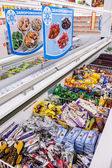 Showcase with frozen products in supermarket — Stock Photo