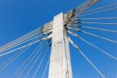 Pillar of cable bridge against blue sky — Stock Photo