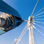 Modern cable bridge pylon against blue sky — Stock Photo #55494951
