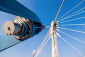 Modern cable bridge pylon against blue sky — Stock Photo