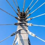 Modern cable bridge pylon against blue sky — Stock Photo #55700377