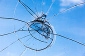 Closeup of smashed glass panel cracked and broken — Stock Photo