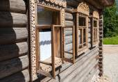 Windows on the facade of the old wooden house — Stock Photo