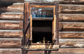Open window in the old rural wooden house — Stock Photo