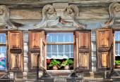 Windows on the facade of the wooden house. Old Russian country s — Stock Photo