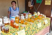 SAMARA, RUSSIA - SEPTEMBER 7, 2014: Women seller of honey on the — Stock Photo